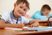 10325359-portrait-of-smart-lad-at-workplace-with-classmates-on-background[1]