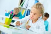 14645044-portrait-of-lovely-girl-drawing-with-classmates-on-background[1]